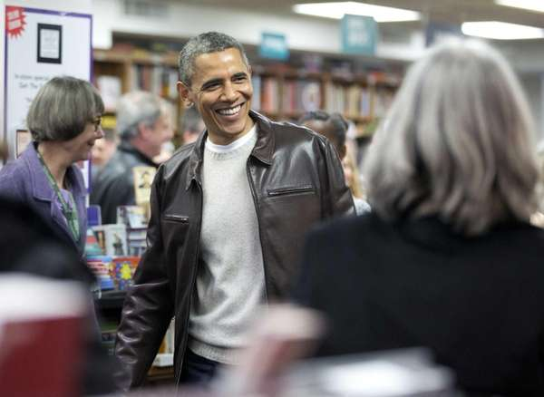 President Barack Obama greets shoppers as he shops