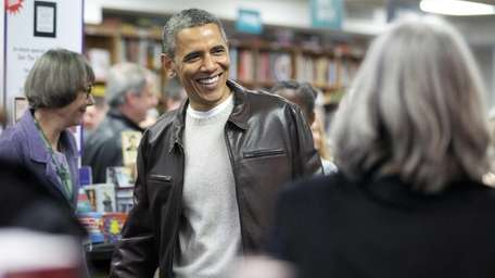 President Barack Obama greets shoppers as he shops