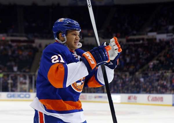 Kyle Okposo celebrates his second goal of the