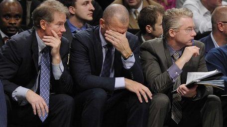 Nets head coach Jason Kidd, center, reacts in