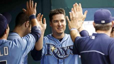 Tampa Bay Rays' Kelly Johnson, center, is congratulated