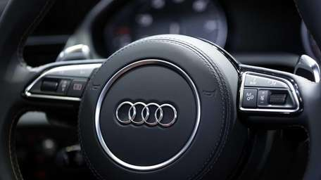 The Audi AG logo sits on the steering
