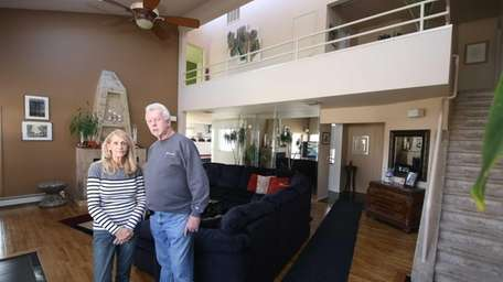 Paul and Linda Pusak stand in the living