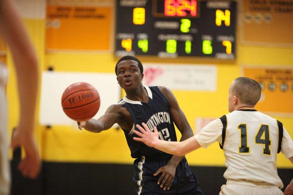 Huntington's Kenny Charles, left, passes the ball around