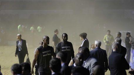 Players of the Minnesota Timberwolves leave as smoke
