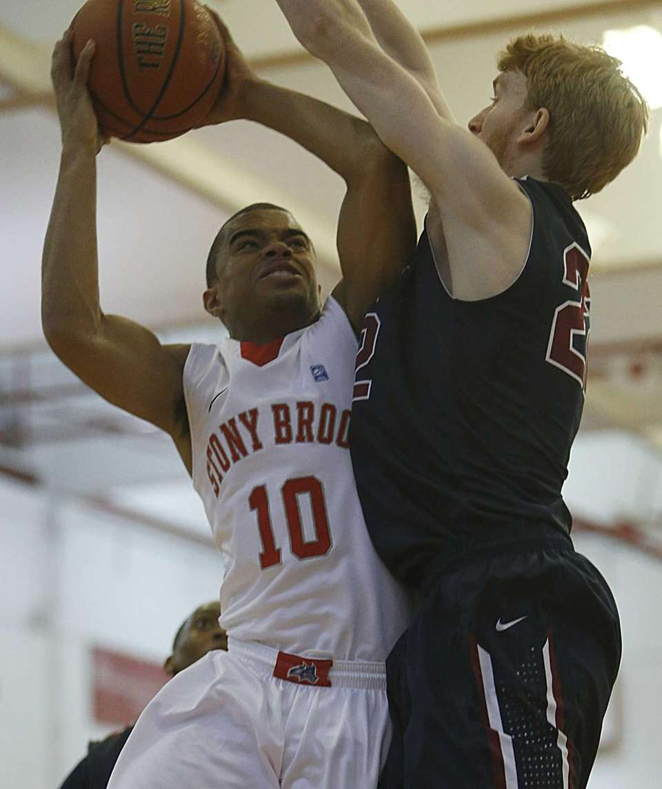 Stony Brook Seawolves guard Carson Puriefoy is fouled