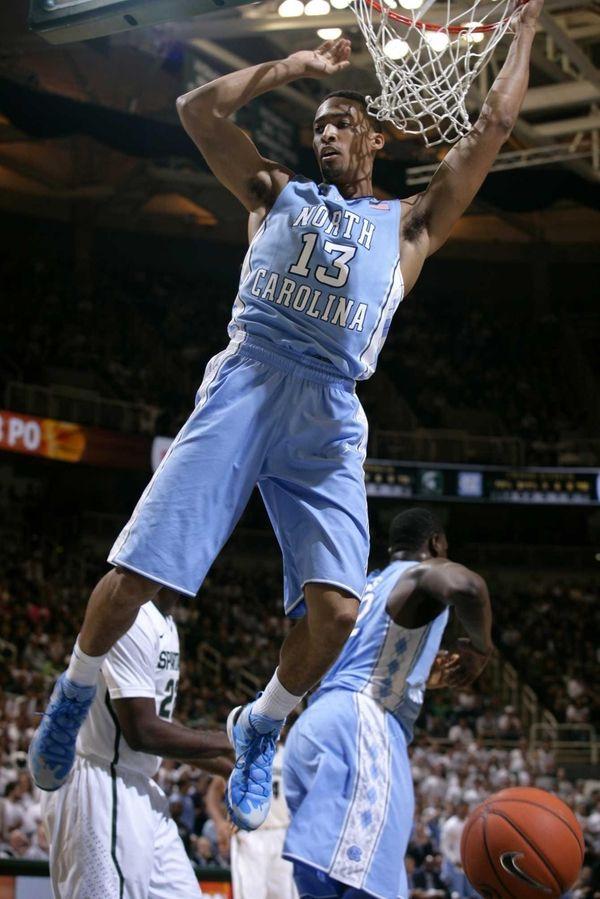 North Carolina's J.P. Tokoto dunks during the first