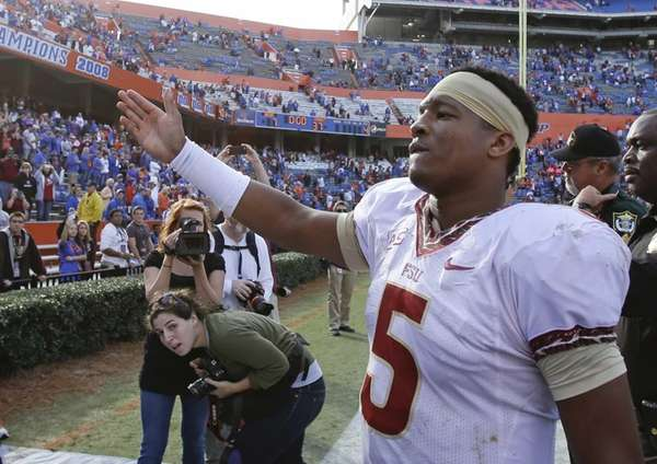 Florida State quarterback Jameis Winston does the tomahawk