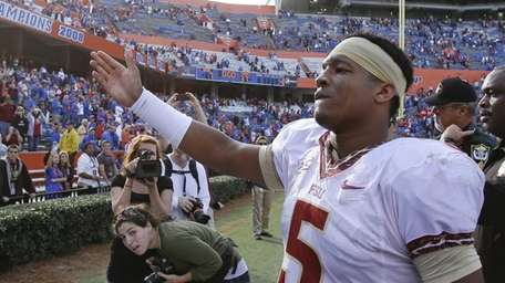 Florida State quarterback Jameis Winston does the tomahawk