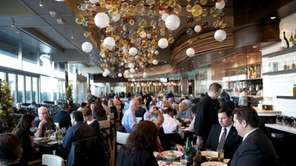 A group of diners linger over lunch at
