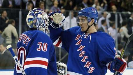 Henrik Lundqvist #30 and Ryan McDonagh #27 celebrate