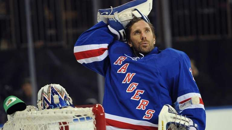Henrik Lundqvist of the Rangers looks on before