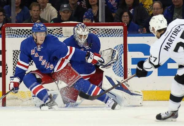 J.T. Miller and goaltender Henrik Lundqvist of the