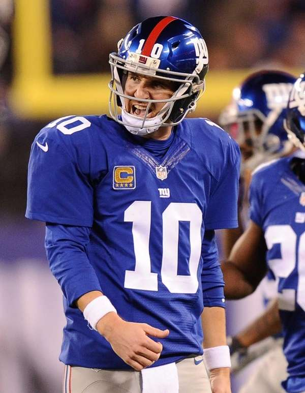 Eli Manning reacts during the first half against