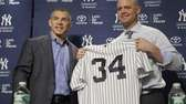 Brian McCann, right, poses for a picture with
