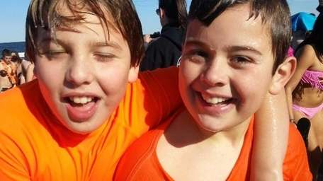 Roman Altherr,11, and Noah Bila, 10, soaking wet