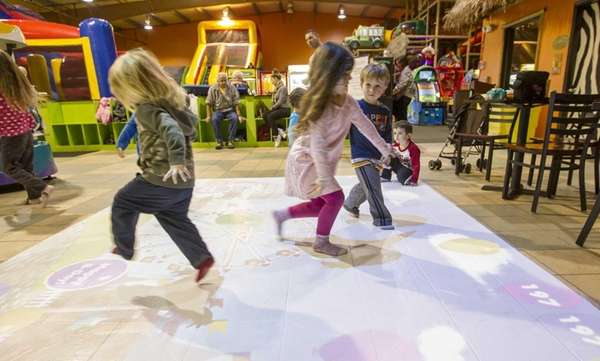 "Kids play on ""Motion Commotion,"" a new motion"