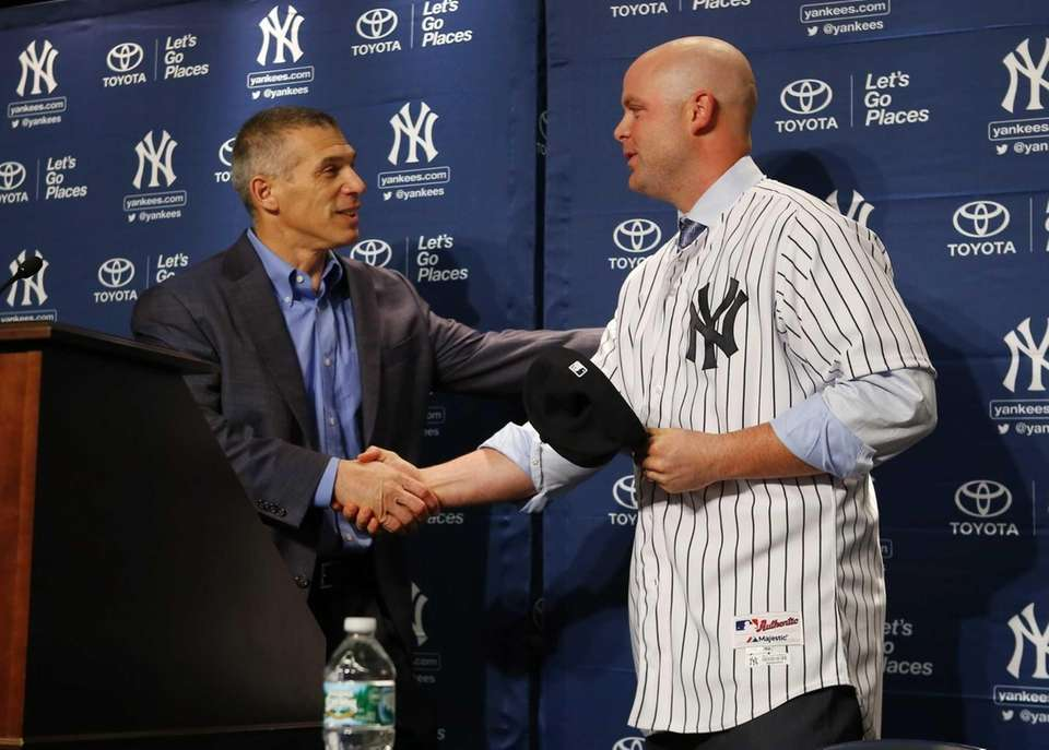 Joe Girardi shakes hands with Brian McCann during