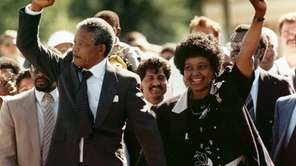 Nelson Mandela and his wife, Winnie, raise clenched