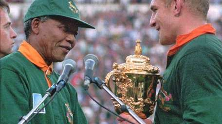 South African rugby captain Francios Pienaar, right, receives