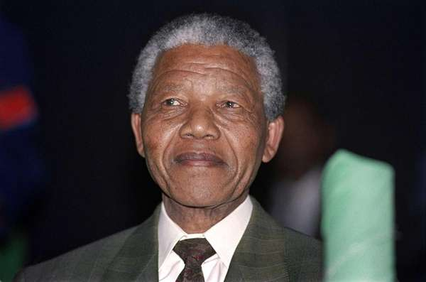 Nelson Mandela smiles after being unanimously elected as