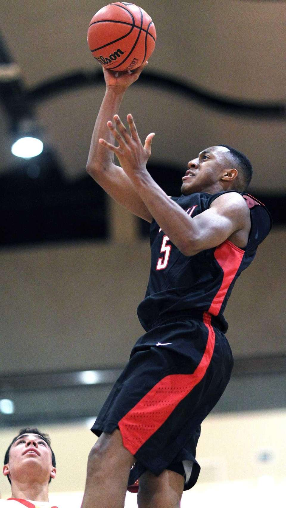 Lutheran's Elijah Bailey takes the shot during a
