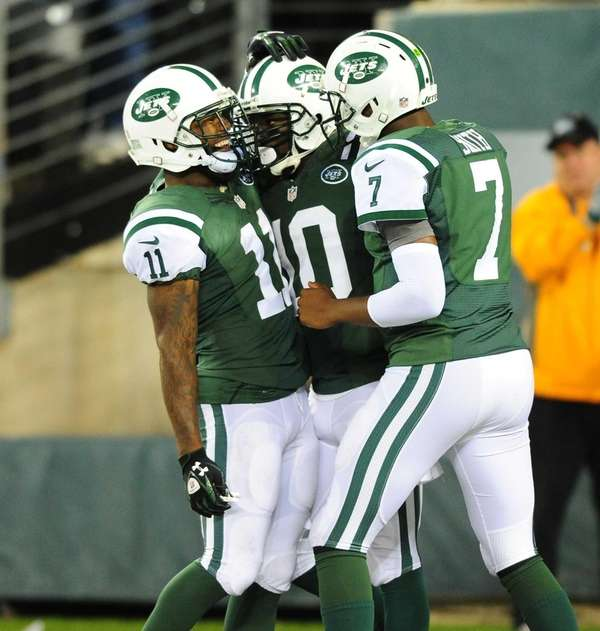 Santonio Holmes celebrates game-winning touchdown with Jeremy Kerley