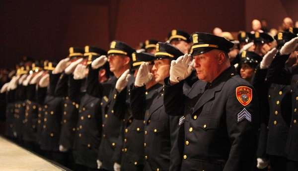 Suffolk County Police Department cops salute during a