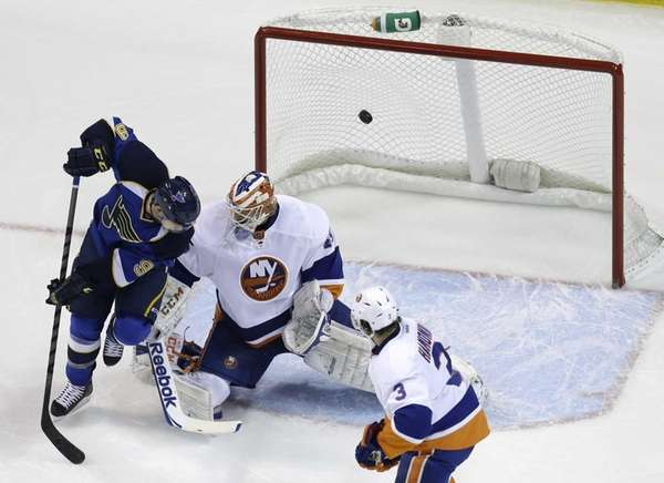 The St. Louis Blues' Jaden Schwartz, left, watches