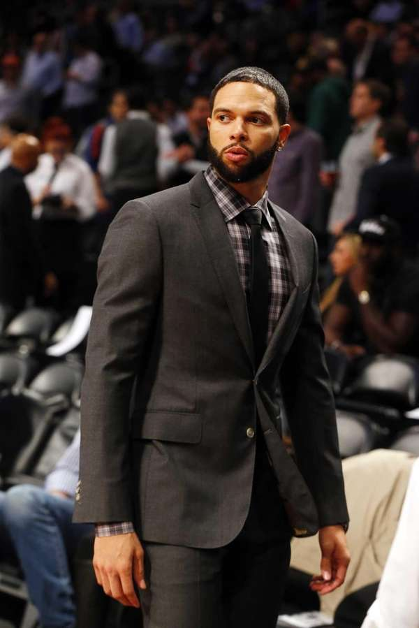 Deron Williams looks on before a game against