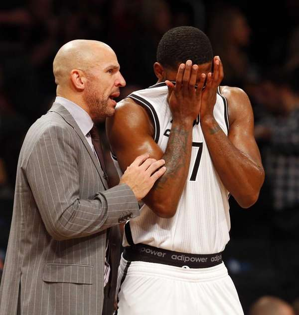 Jason Kidd talks with Joe Johnson during the