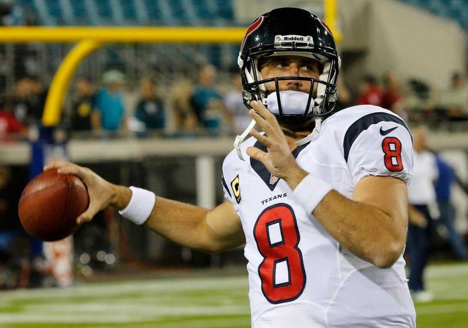 Matt Schaub of the Houston Texans warms up