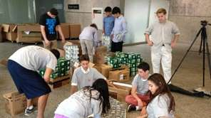 Friends Academy engineering students sort donated cans of