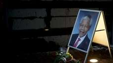 Tributes to Nelson Mandela outside the South African