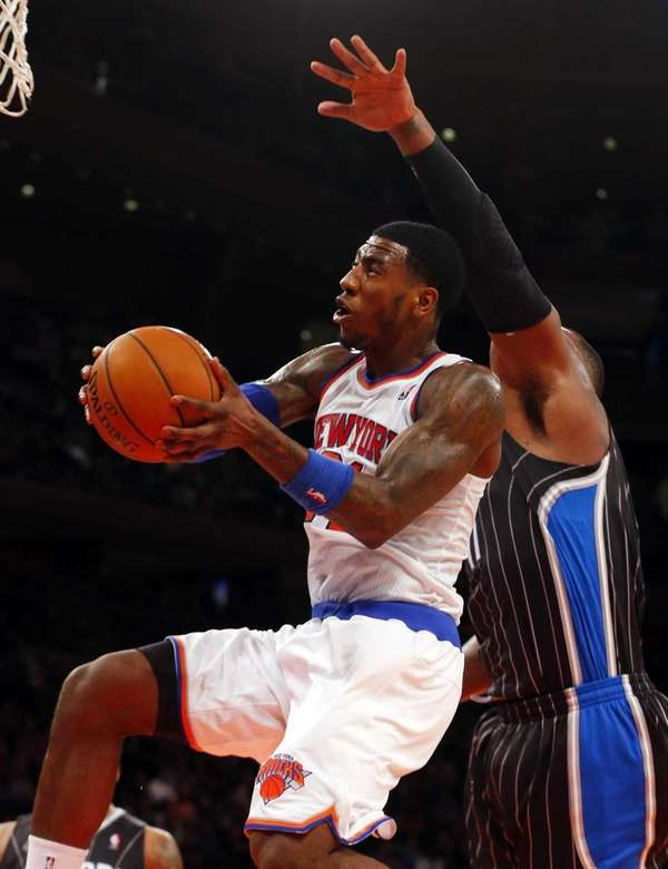 Iman Shumpert of the Knicks goes to the