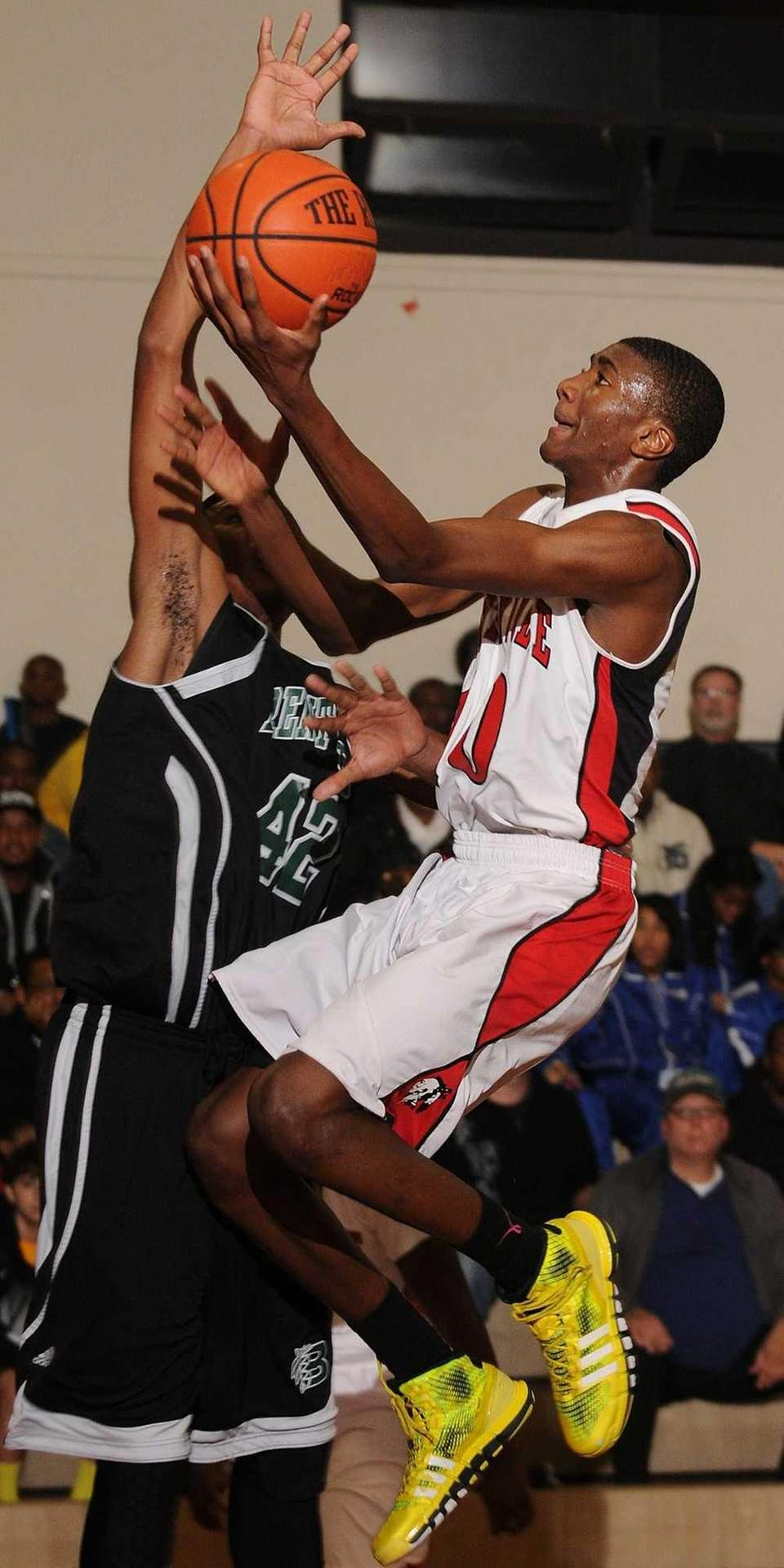 Amityville's Travis Dickerson, right, draws a foul on