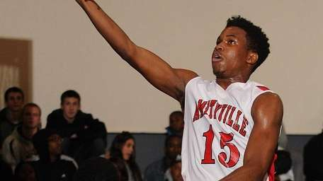 Amityville's Leland Williams drives to the basket for