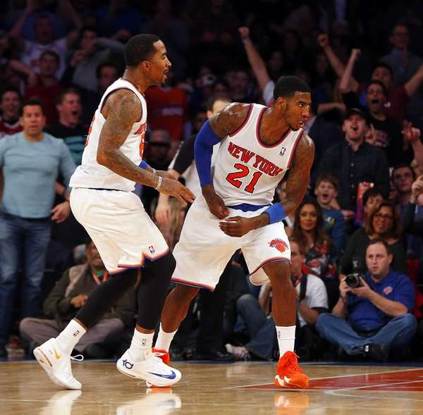 Iman Shumpert of the Knicks celebrates a dunk