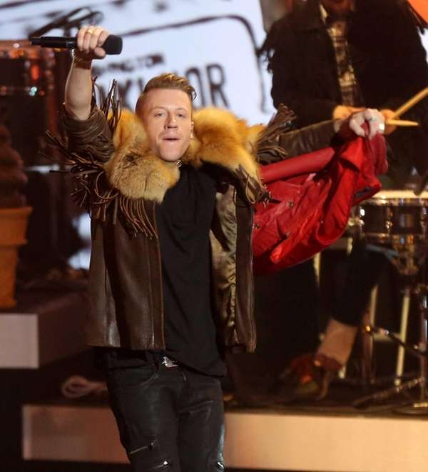 Recording artist Macklemore performs onstage during The Grammy