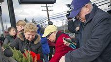 Congresswoman Carolyn McCarthy, center in the red coat,