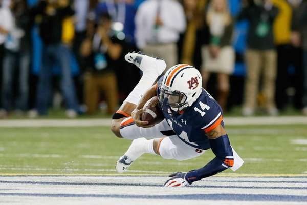 Quarterback Nick Marshall of the Auburn Tigers falls