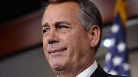 Speaker of the House Republican John Boehner reacts