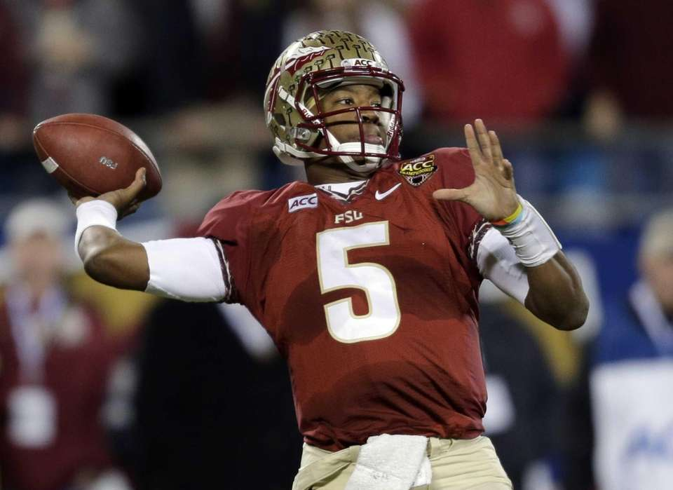 Florida State quarterback Jameis Winston (5) looks to