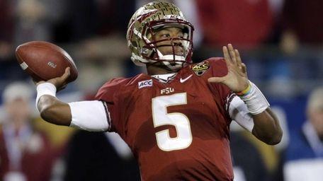 Florida State quarterback Jameis Winston (5) looks to