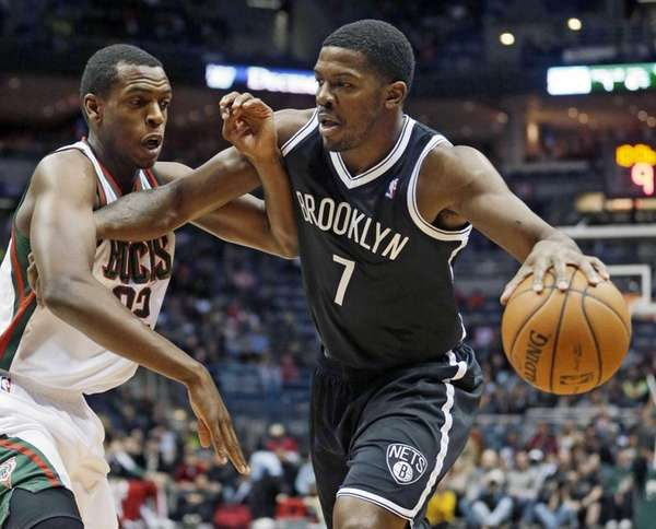 Nets' Joe Johnson tries to drive past Milwaukee