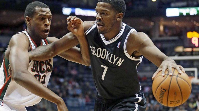Nets' Joe Johnson tries to drive past Milwaukee