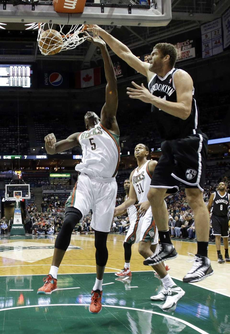 Nets' Brook Lopez dunks over Milwaukee Bucks' Ekpe