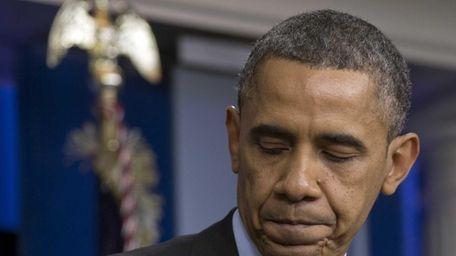 U.S. President Barack Obama turns from the podium