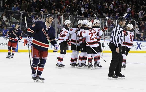 The New Jersey Devils celebrate their 4-3 overtime