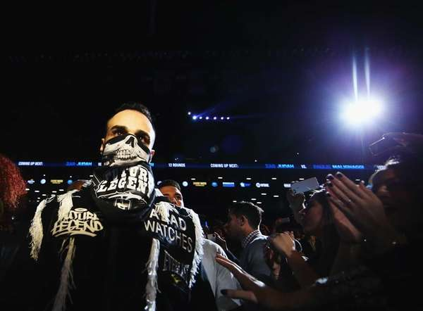 Paulie Malignaggi enters the ring against Zab Judah